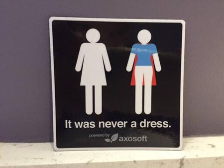 image a women's bathroom symbol, in which the dress is revealed to be a superhero cape