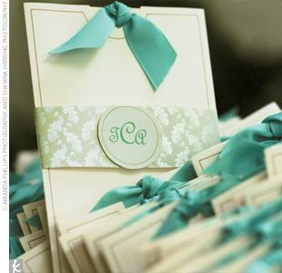 pretty!!! The programs offered the first hint of the wedding's signature colors of Tiffany blue and white: White booklets were placed in crisp white envelopes wrapped with a Tiffany blue ribbon and stamped with the couple's monogram, also in Tiffany blue.