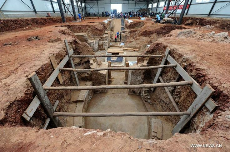 Photo taken on June 22, 2013 shows the archeological site of an ancient tomb in Fangshan District of Beijing, capital of China. A gravestone...