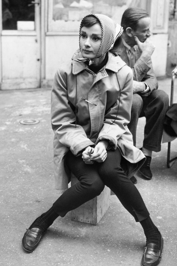 1956. Sitting on a crate near the Eiffel Tower while filming Funny Face