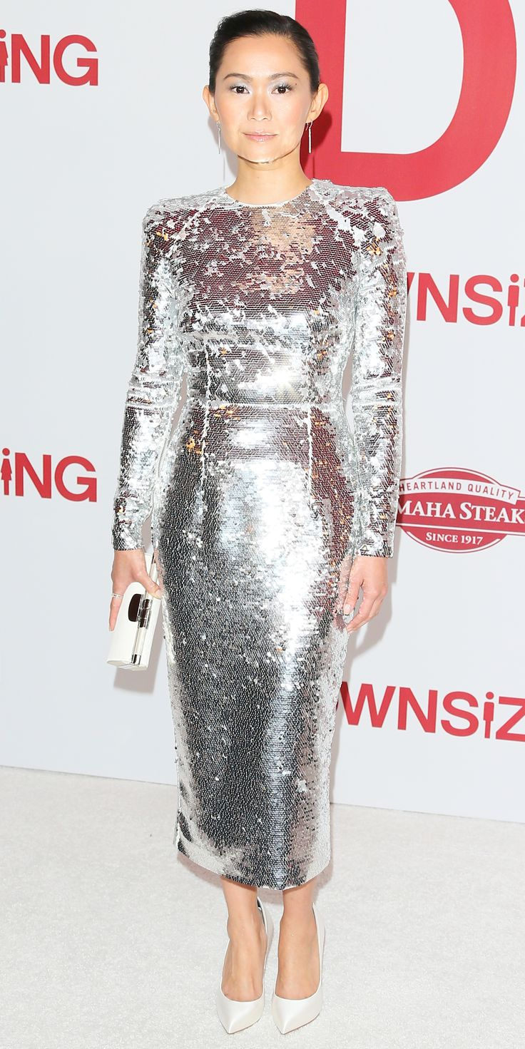 Look of the Day- Hong Chau- During the premiere of Downsizing, actress Hong Chau shut down the red carpet wearing a silver Alex Perry dress. Just when we thought the look couldn't get any better, her stylist perfectly elevated the dress with a white clutch and coordinating pumps.