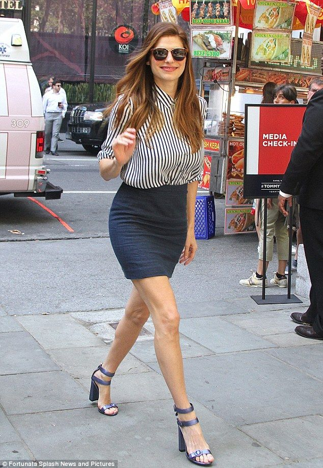 Strutting through the Big Apple! Lake Bell got leggy in a navy mini-skirt while attending a Tommy Hilfiger event at Manhattan's Bryant Park on Tuesday