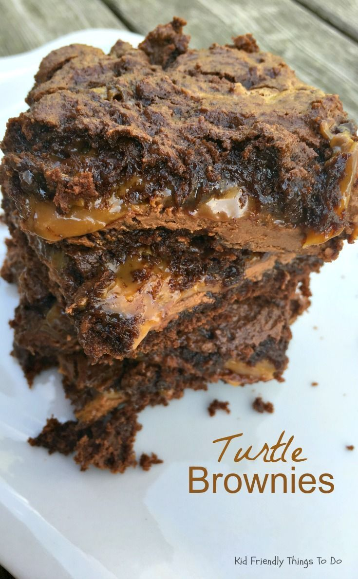 Chewy, Gooey, Loaded Turtle Cake Brownies - Easy to make. Oozing with caramel and tons of chocolate! The best! KidFriendlyThings...