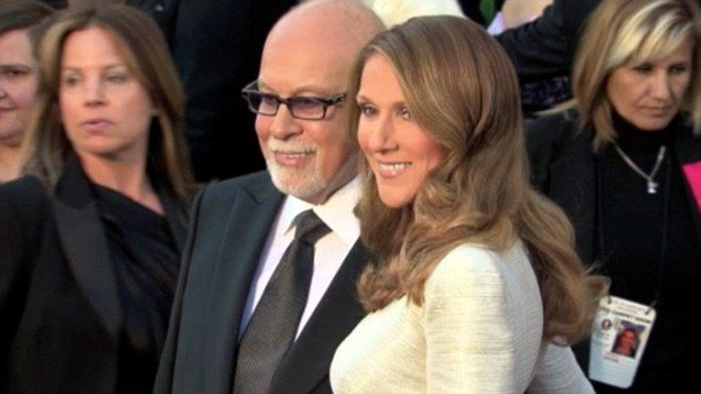 Celine Dion and husband Rene Angelil walk the red carpet at the 2011 Oscars.