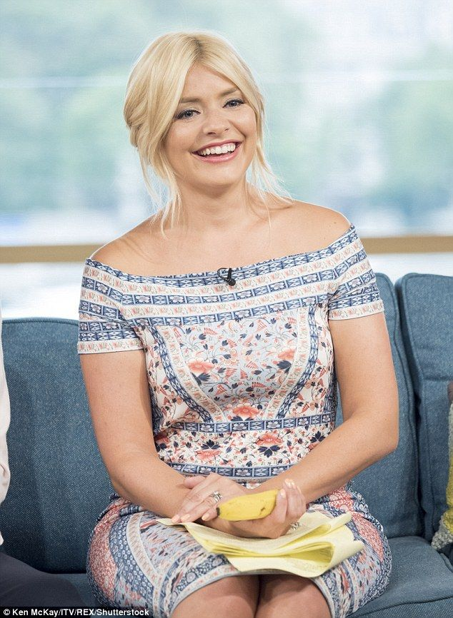 Stunning:Once they were back on their feet, Holly, 35, showed off her stunning dress for the day's appearance, and it's clear it looked better on her than on her wigged stunt double
