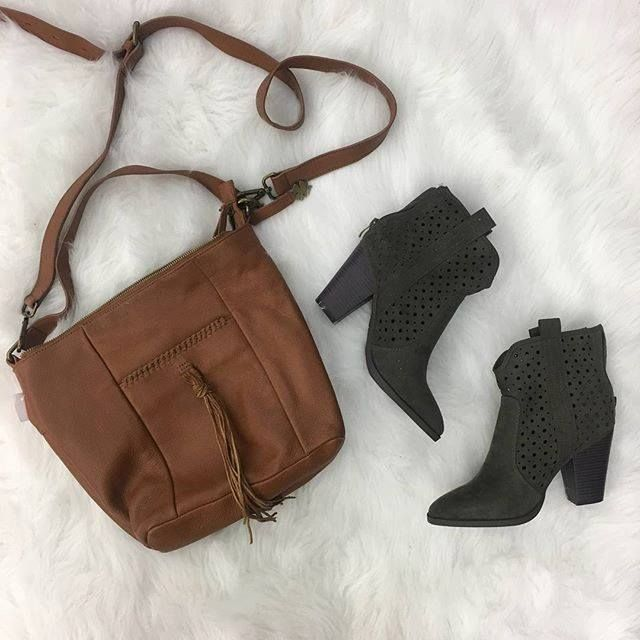 Cute accessories are a staple to any closet! These booties and purse at our Harwood Heights store are a must have! Call to pay and pick up: 708-867-2800 | Purse: Lucky Brand $25 | | Booties: Just Fab 7.5 $16 | http://ift.tt/2Dp6ilf - facebook.com/rlwonderland