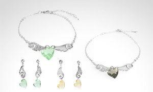 Groupon - Conjunto Alas de Ángel con cristales Swarovski Elements, en colores a elección. Incluye despacho. Precio Groupon: $19.990