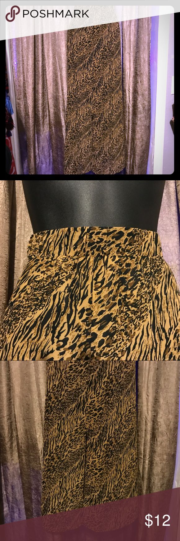 Long cheetah skirt Simple and sweet cheetah print skirt, great with simple brown tee and sandals for on the go. Well loved. The elastic band moves around a bit but once on it stays in place. robert louis Skirts Maxi