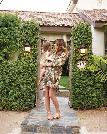 Make It Lush  Create a green welcome with simple plant solutions like ficus. Fast-growing vines such as these will quickly cloak walls and soften a rustic wooden gate, which is the entrance to the Andersons' small front garden.