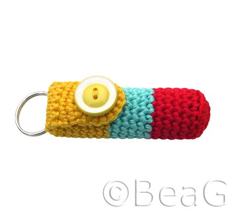 "crochet lip balm case/key tag.  My husband might approve (on our mutual set of keys) if it were made in ""manly"" colors"