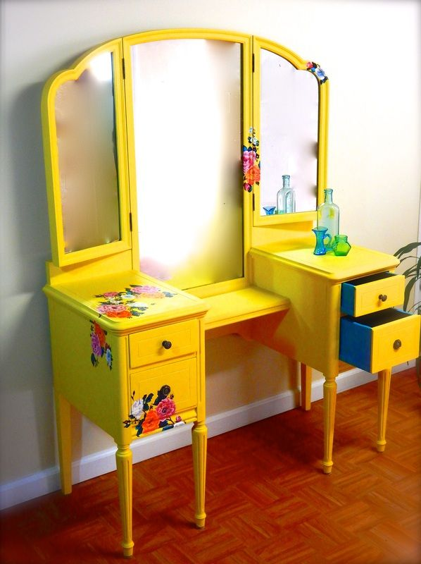 Yellow vanity with hand-painted floral design.