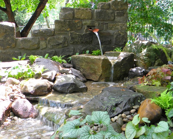 Waterfeature--rustic, ruined wall and trough/stone.