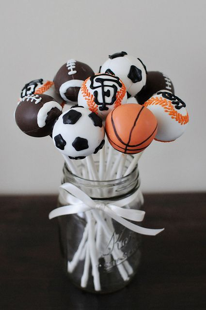 awesome sports theme baby shower cake pops - @Angela Gray Nason we have a cake pop machine!