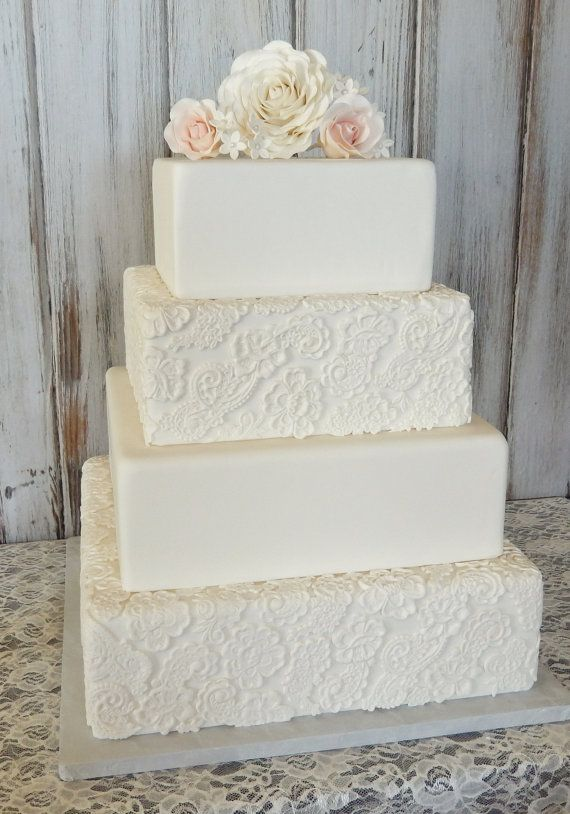 "love the look of the lace on the tiers. we can do this to our ""fake tiers"" easily and have our top tier be real cake with our cupcakes surrounding in a nice display"