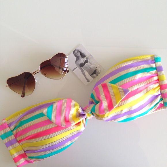 VS Bandeau Bikini Top Victoria's Secret Multi Color Bandeau Bikini Top. Has removable neck strap and back clasp. Size Large but runs small. Fist like a Medium. Has some signs of wear see last photo. Overall Good Condition. Victoria's Secret Swim Bikinis