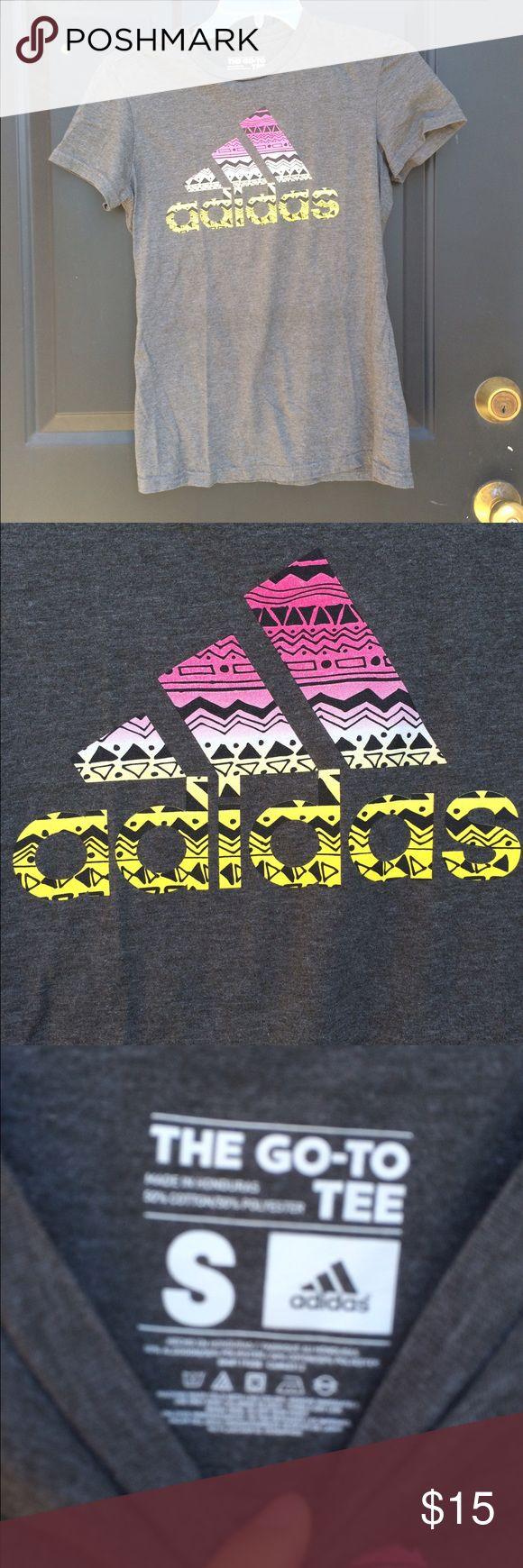 Did as Grey Aztec Top Worn only a few times. Heather grey colored Tshirt with various colored Aztec print on the logo. Cotton style top Adidas Tops Tees - Short Sleeve