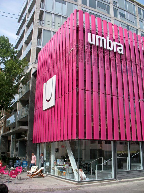 Large impact with just vertical colored slats. http://www.contemporist.com/photos/umbra_store_toronto.jpg