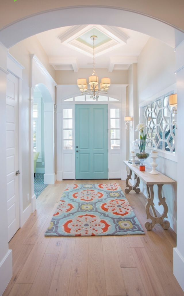 A patterned rug will really tie that entryway together! The front door makes an amazing focal point of the room.