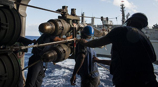 ATLANTIC OCEAN (Nov. 18, 2017) Sailors aboard the amphibious assault ship USS Wasp (LHD 1) prepare to connect a fueling probe  during a replenishment-at-sea with the dry cargo and ammunition ship USNS Robert Peary (T-AKE 5). Wasp is transiting to Sasebo, Japan, to conduct a turnover with the USS Bonhomme Richard (LHD 6) as the forward-deployed flagship of the amphibious forces in the U.S. 7th Fleet area of operations. (U.S. Navy photo by Mass Communication Specialist 3rd Class Levingston…