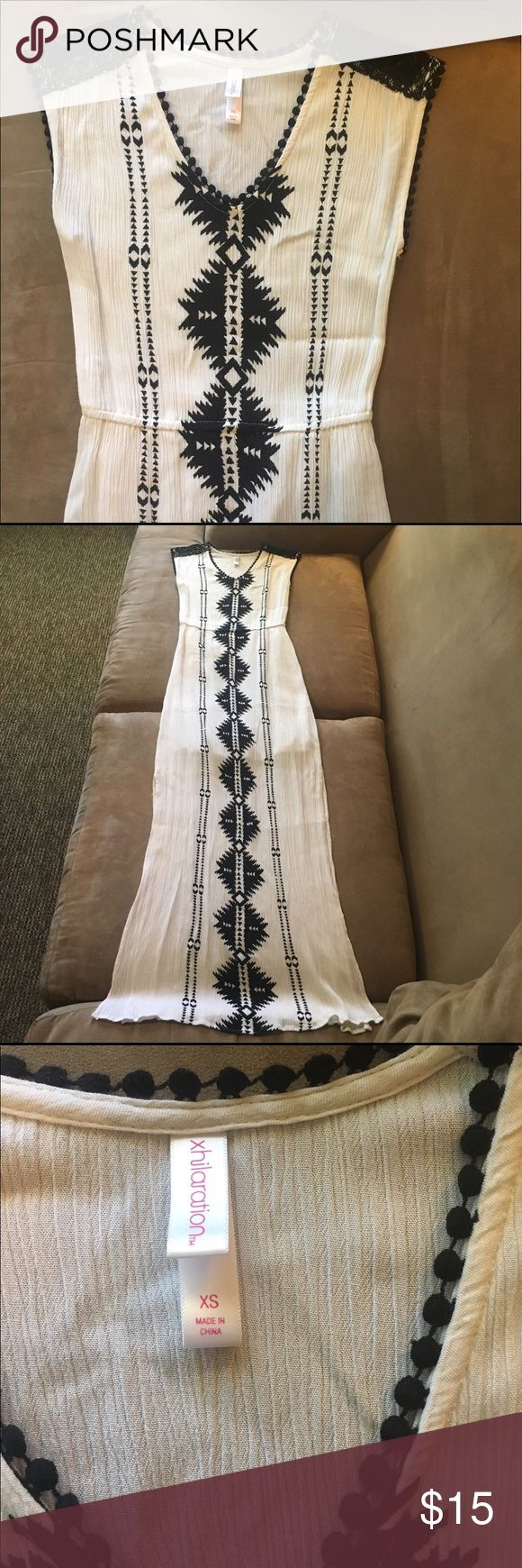 Aztec Maxi Dress This off-white colored ribbed maxi features a black Aztec print with lacy details on the shoulders. Lined to just above the knee. Two slits to the knee on either side. I am 5'7 and this comes to my ankles. No trades, sorry! Xhilaration Dresses Maxi
