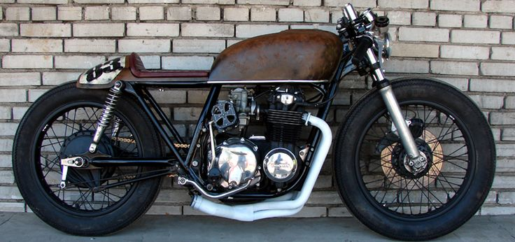 Honda CB750 - Custom Motorcycle. It's a cafe racer but I love the overall shape and character of the bike. Well done.