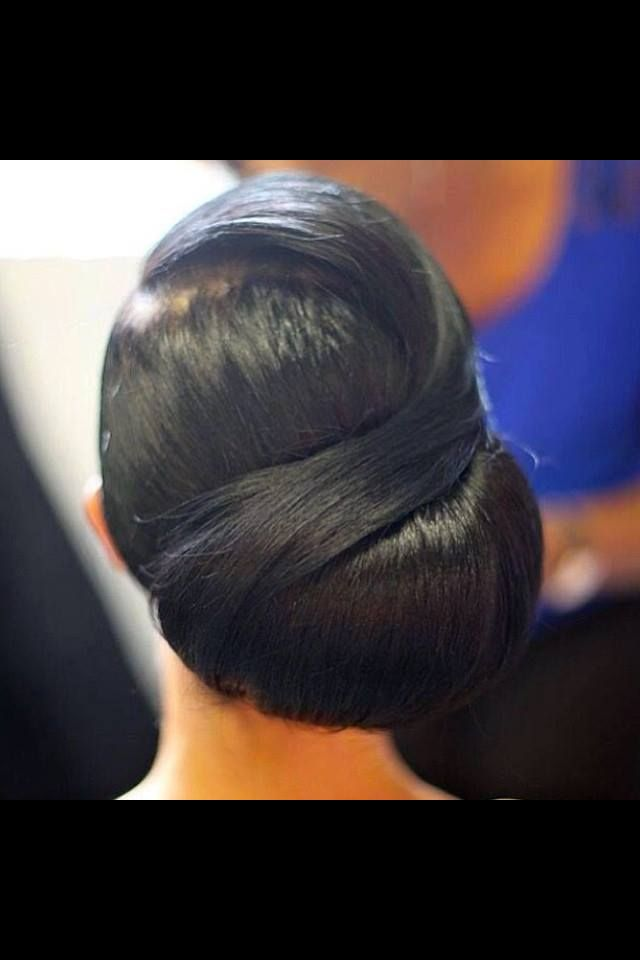 Simple sleek wedding hair style.  Classic for formal occasions.  Large bun, with swoop