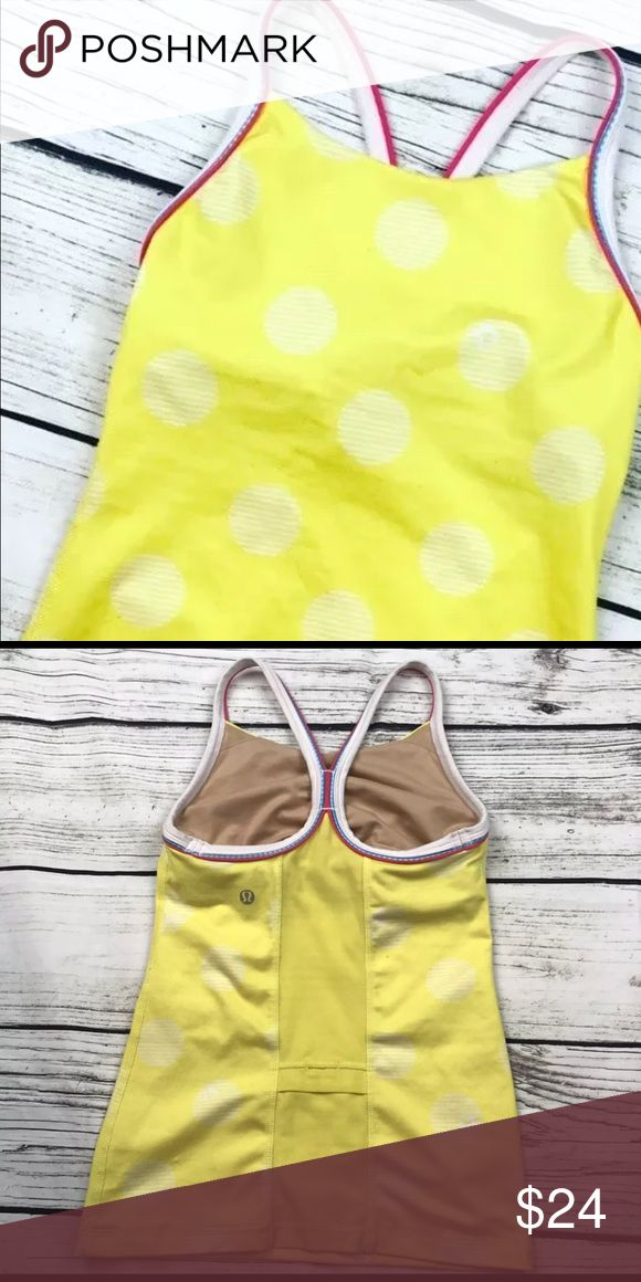 Lululemon Size 2 polka dot built in bra tank top Yellow Lululemon polka dot tank top with built in bra and pocket in the back. Size 2. lululemon athletica Tops Tank Tops