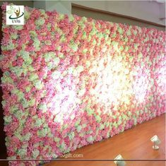China UVG 2.4m curved big fake flower wall wedding backdrops in silk rose and hydrangea for sale supplier