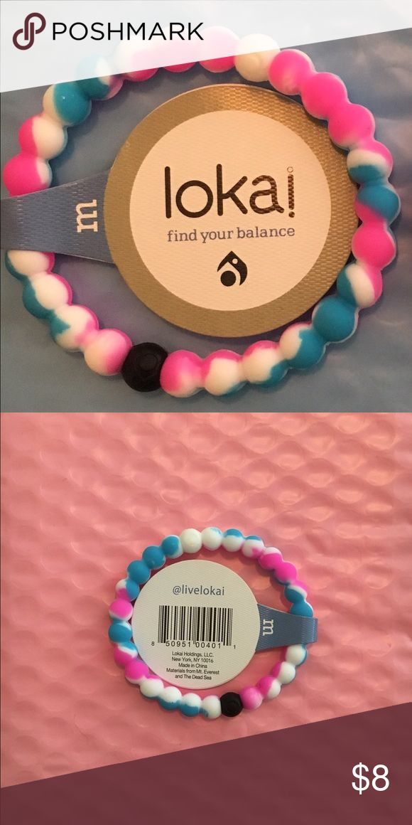 Lokai Pink, white & blue Lokai bracelet, size medium. Cross posted. On the real Lokais the Lokai symbol is on the white bead and the black bead. On the back of the tag the real Lokais say @livelokai I can provide pictures of the white & black beads that have the Lokai symbol. Lokai Jewelry Bracelets