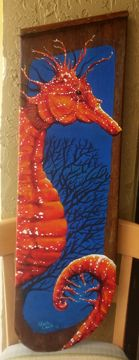 Orange Seahorse painted on an antique Sailboat Keel. $185
