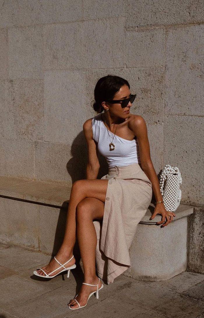 Easy Outfit Ideas: a white tank top worn with a linen skirt and strappy sandals