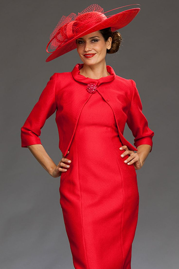 Knee length fitted dress with a round neckline and long tail at the back. This elegant dress comes with a coordinating jacket. The jacket has ¾ sleeves and a brooch to fasten. Product Code: 83888/83880 Colour: Red