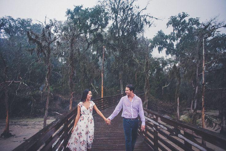 Engagement photo in the rain! Jenny & Kevin | Alpine Groves Park - Wedding Photographers based in Jacksonville, Fla.
