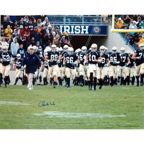 Charlie Weis Walking with Team on the Field 16x20 - Charlie Weis graduate of the University of Notre Dame made his name in the coaching world as the offensive coordinator of the New England Patriots. After helping them to win four different Super Bowls Weis then decided to return to his alma mater as the head football coach. He coached at Notre Dame from 2005 to 2009 before accepting the job as head offensive coordinator for the Kansas City Chiefs. Charlie Weis has hand signed this great…