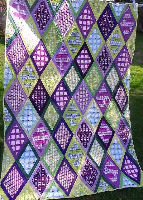 Finished Tufted Tweet quilt! by Little Island Quilting, via Flickr MARDI GRAS