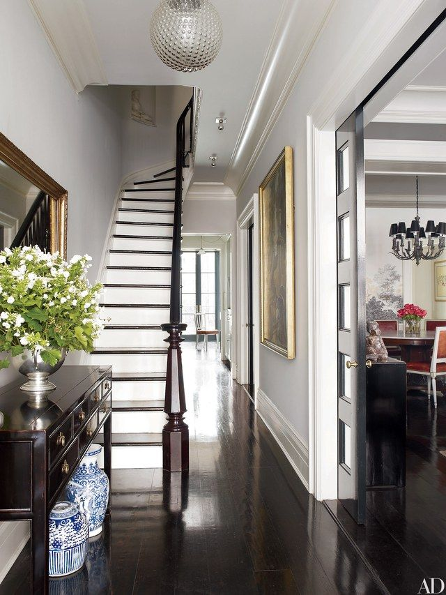 The foyer of Brooke Shields's New York City townhouse, decorated by David Flint Wood, is furnished with an 1860s Chinese desk adorned with decorative blue-and-white vessels.
