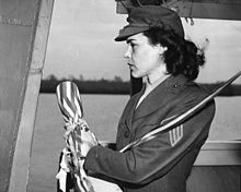 Sgt Lena Mae Basilone, USMC(WR) prepares to christen the destroyer USS Basilone