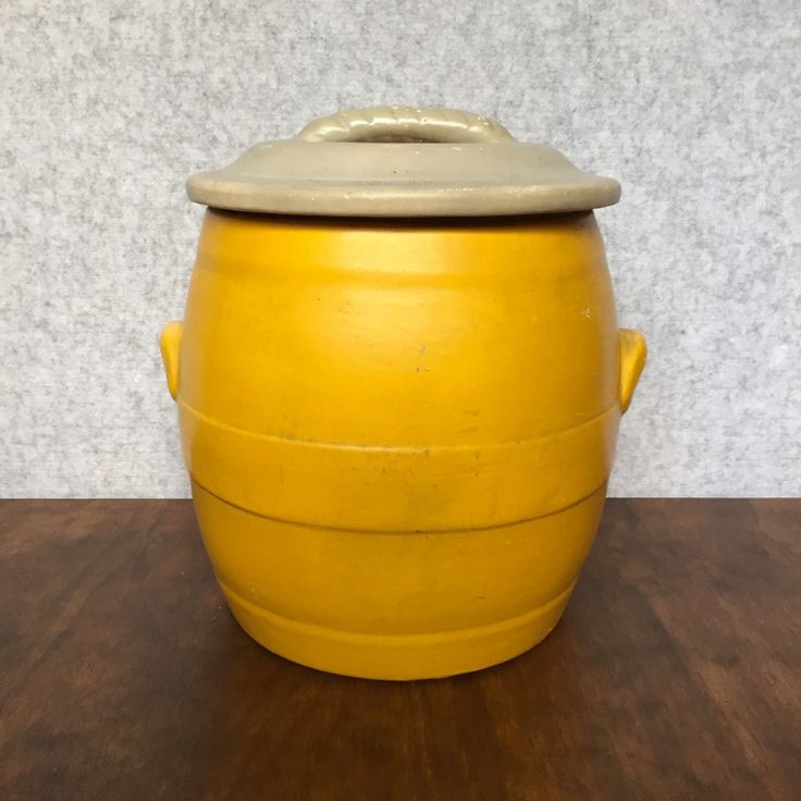 VINTAGE CERAMIC BREAD BIN WITH LID - $125 AUD  In bright yellow, with a light grey lid, this vintage ceramic bread bin shows signs of its age and use with various marks and scratches, but that's why we love it.  Great as a bright statement piece in the kitchen, or even as a planter.