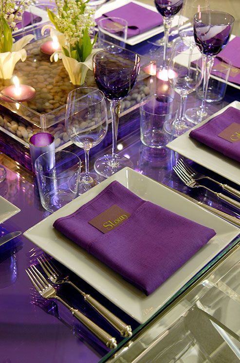 Eggplant colored napkins are paired with mint green dinner plates for this violet afternoon tea.