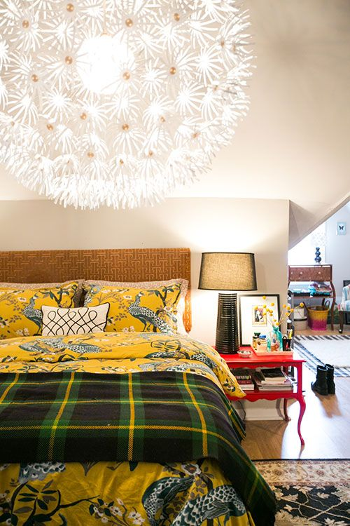 """Sneak Peek: Jessica McKay and Christopher Van Buskirk. """"We converted our attic into a master suite. I love the angles that it created and it is a little retreat from the rest of our house. The bedding is Dwell Studio, but the plaid blanket was my grandparents'. I made the headboard and also painted the vintage nightstands (that were free from a friend!)."""" #sneakpeek"""