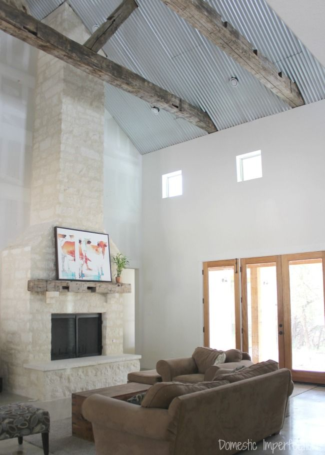 corrugated metal ceiling, rustic beams and stone