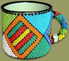 A very stylish and unique handmade mug from Africa's Tin collection.  Checkout https://gosouvenirsafrica.com/ for more.