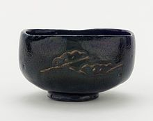 Learn something new each day....Japanese (traditional raku vs modern western raku) Tea bowl with designs of pine boughs and interlocking circles, unknown raku ware workshop, Kyoto, Edo period, 18th-19th Century