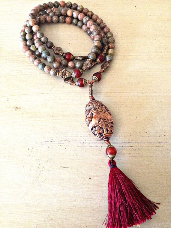 Immerse and transform yourself in the ancient spiritual tradition of Mala Meditation with a VividLifeMala. Tibetan Style Mala with Jasper (Spiritual Meaning, Healing) Red Jade Marker Beads and Tibetan Copper Pendant (Spiritual Meaning, Receptive) handmade in Nepal. Mala handmade in Canada and thread with 100% silk.