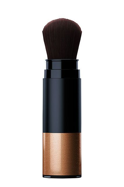 """Jay Manuel Beauty Skin Face Lift in Gold   Those with dark skin should simply enhance the glow they already have, Barose says. """"Sometimes people go crazy on the browbone, the nose, and on the upper lids — but on darker skin, it's definitely not necessary... It can make you look greasy, which isn't what we want.""""This bronze-colored powder from Jay Manuel Beauty doesn't add additional oil and comes with a super-soft br..."""