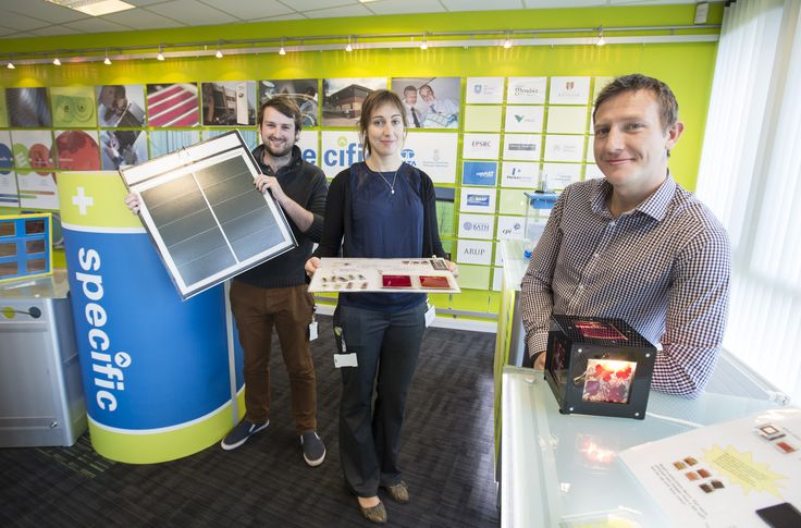 Members of the SPECIFIC team show off new generation solar cells - minimalistic and printable materials that can be incorporated into buildings' own structure