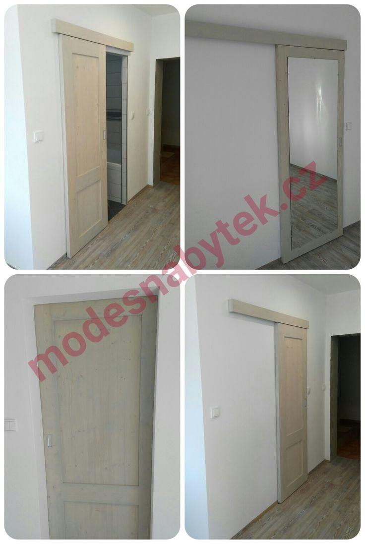 Masivní posuvné dveře, voskované. Tlumením dovírání i otevření.