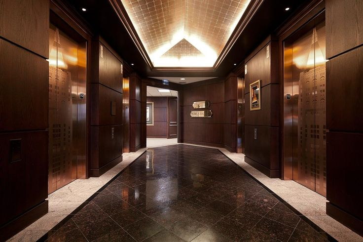 Elevator doors shown in fused bronze with satin finish and