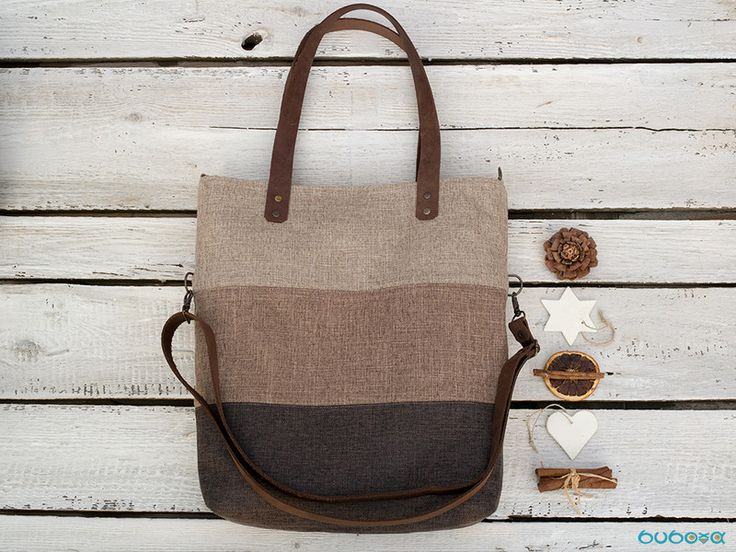 This tote bag is made of heavy duty washable brown, beige and light brown fabric. You can wear it 3 different ways. The long adjustable leather strap can be attached 2 ways or simply detached....