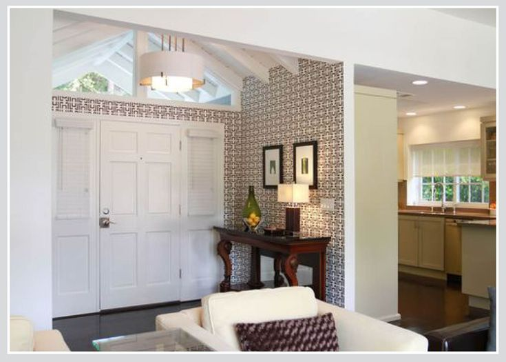 Entranceway is well defined with wallpaper and sets a homes' 'tone'